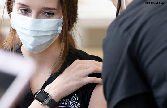A woman receives the Janssen vaccine