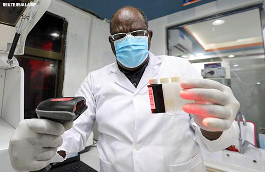 A lab technician runs test for covid-19 in Somalia