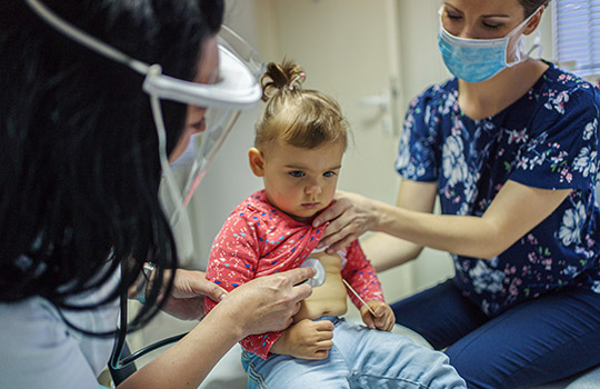 Child being seen by a doctor