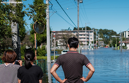 People look on at flooding in Japan