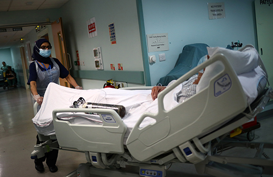A patient being admitted to hospital with covid-19